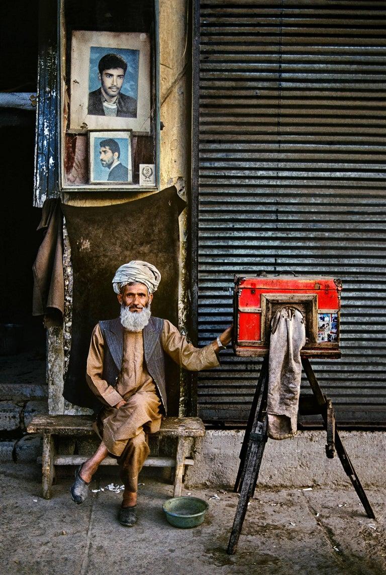 Portrait Photographer, Afghanistan - Steve McCurry (Colour Photography) - Black Color Photograph by Steve McCurry
