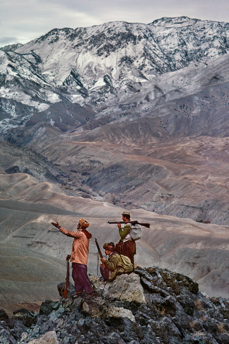 Steve McCurry Color Photograph - Mujahideen Stand Atop a Mountain in the Hindu Kush, 1984