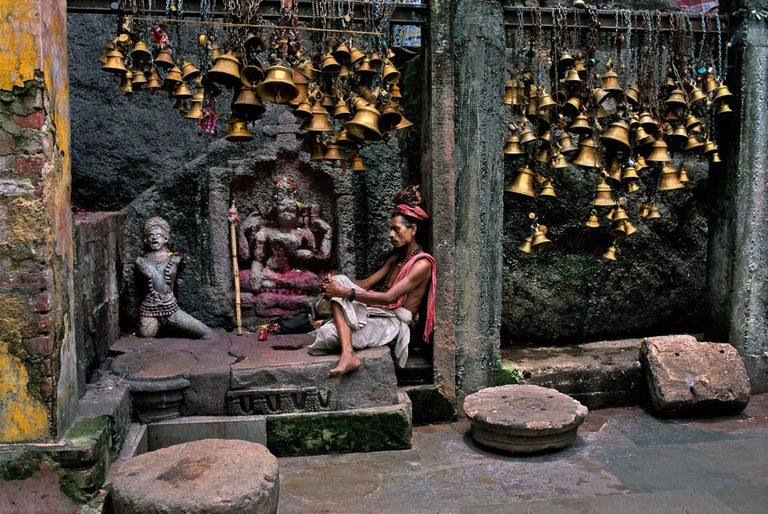 Steve McCurry Color Photograph - Man with Many Bells, Guwahati, Assam, India, 2001