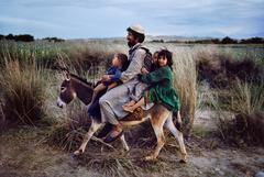 Family Rides Donkey, Afghanistan, 2003
