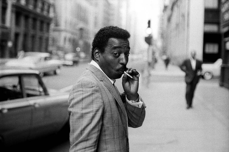 Chico Hamilton in Street, 1962 - Jerry Schatzberg (Portrait Photography) Signed on Reverse Silver Gelatin Print Printed on 20 x 24 inch paper From an Edition of 20  Jerry Schatzberg's portraits are characterised by their narrative quality, combining