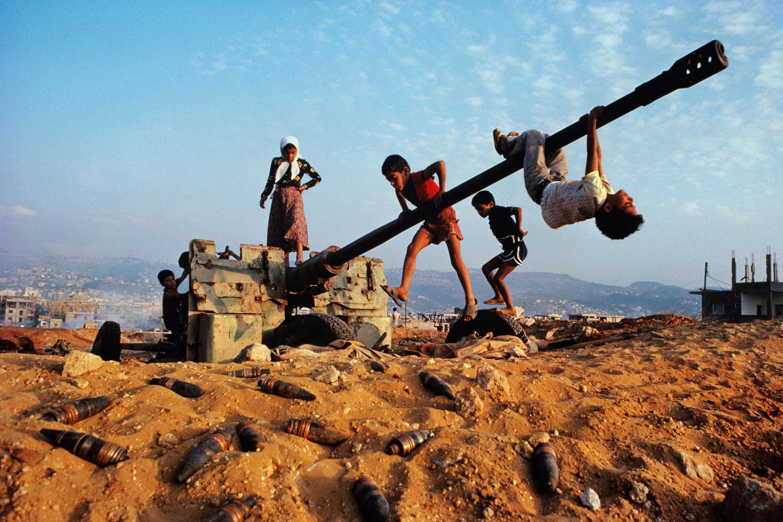 Children Play on Tank, Lebanon, 1982 - Steve McCurry (Colour Photography)