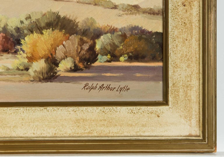 An early-mid 20th century oil painting by American artist Ralph Arthur Lytle, depicting an American desert landscape. Signed by the artist to the lower right, painted on canvas. Presented in a mid century frame.   Provenance: Mrs Les Burwell