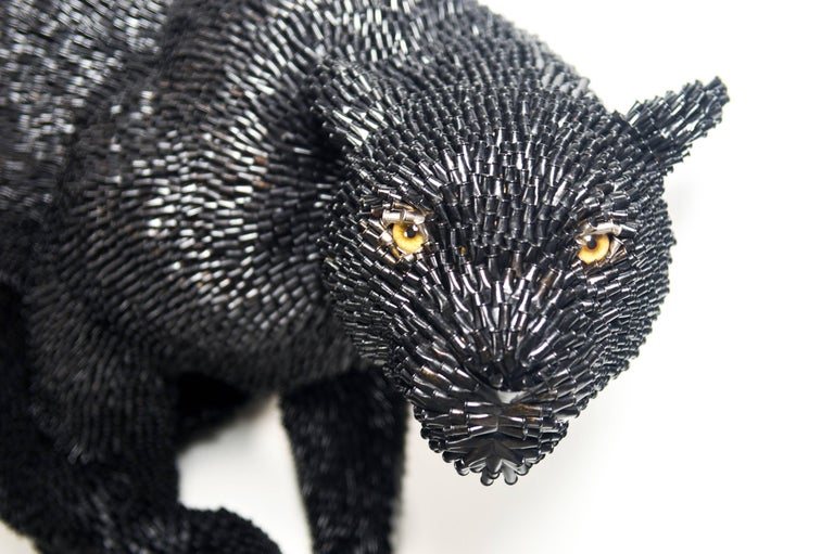 An amazing, new wall-mounted sculpture made out of bullet shells depicting a running, black panther.  Federico Uribe (b. 1962) grew up in Bogota, Colombia. After graduating from the University of Los Andes in Bogota in 1988, Federico continued his