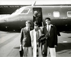 Jean-Michel Basquiat Boarding a Private Jet with Richard Weisman & a Woman