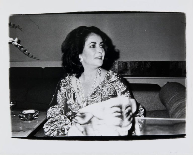 Andy Warhol, Photograph of Elizabeth Taylor at Halston's, circa 1979-1980 - Black Black and White Photograph by Andy Warhol