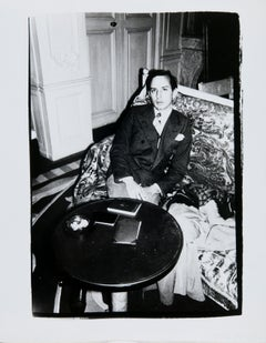 Andy Warhol, Photograph of Fred Hughes Seated at a Table, 1980