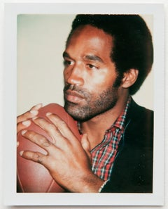 Andy Warhol, Polaroid Photograph of OJ Simpson Holding a Football, 1977
