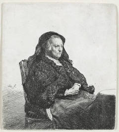 The Artist's Mother seated at a table, looking right: Three quarter length