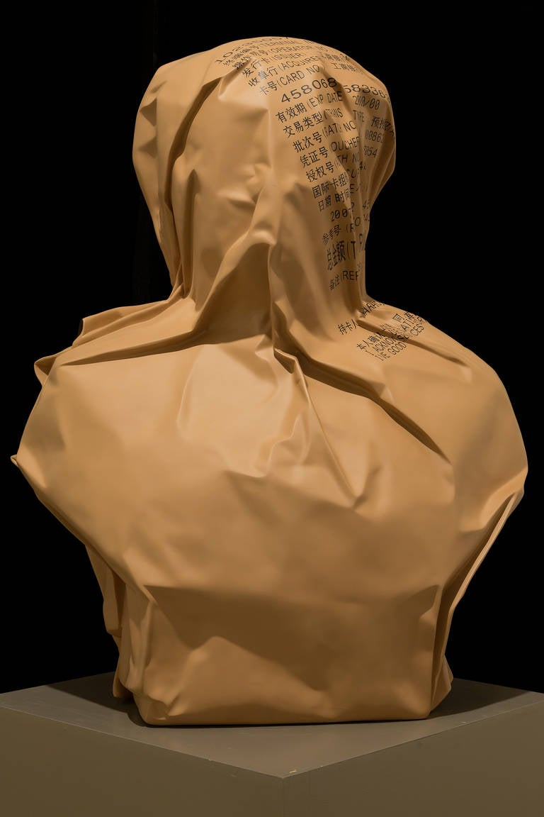 """A fiberglass sculpture, Wrapped Mao, depicts the bust of Mao, wrapped in brown paper by contemporary artist Jiao Xingtao. Signed, in gold marker,  lower left back in Chinese with the edition beneath signature, """"3/8.""""  Born in Chengdu, Sichuan"""
