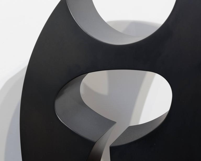 A black, powder coated steel, abstract sculpture by contemporary artist Ed Dean. Signed on bottom,