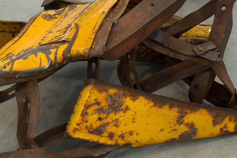 A steel and painted yellow sculpture of a horse by contemporary artist Deborah Butterfield.