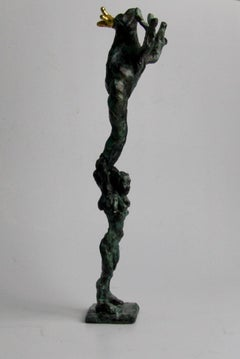 Frog Acrobatics by Helle Crawford, Bronze sculpture of a frog carried by a woman