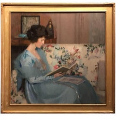 Portrait of a Woman Reading a Book on a Sofa