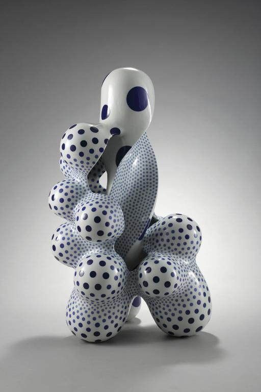 Harumi's work combines incredible complexity with a elegant and refined form.  The dot patterning placed on the surface, one by one, accentuates and compliments the form, making for breathtaking porcelain sculpture. 
