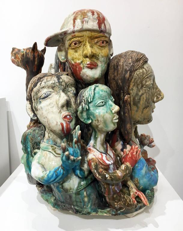 The ceramic sculptures of SunKoo Yuh are composed of tight groupings of various forms including plants, animals, fish, and human figures. While Korean art, Buddhism, and Confucian beliefs inform some aspects of his imagery, implied narratives that