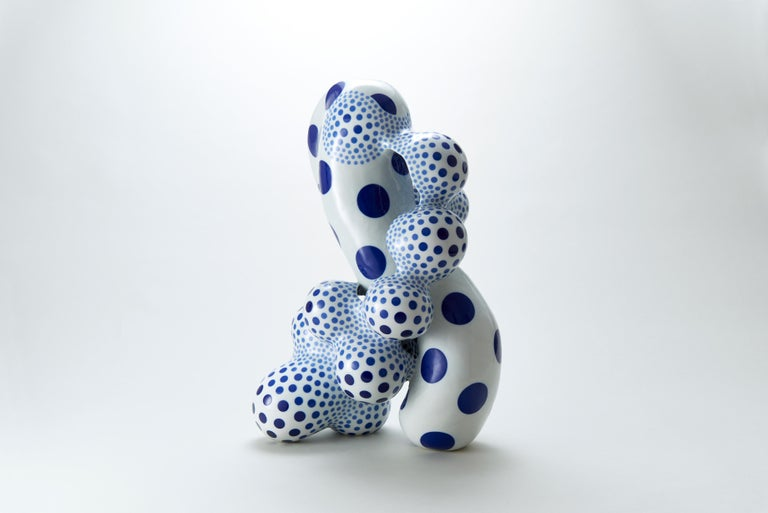 Japanese artist Harumi Nakashima creates free-form ceramic sculptures that feature organic, yet psychedelic characteristics. Nakashima, mostly known for beautifully structured, odd geometric shapes embellished with iconic polka dots, works with a