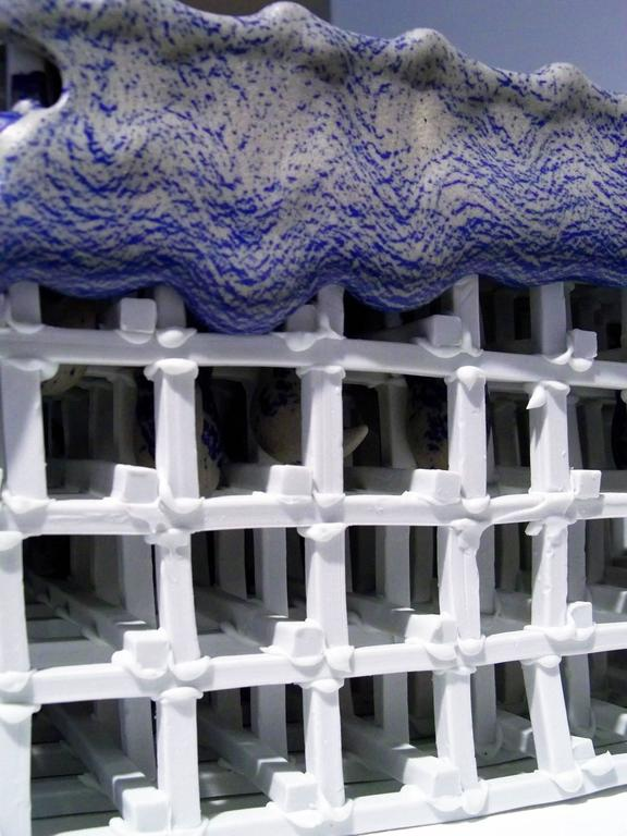My work explores transformation using the kiln as a vehicle for deconstruction. The porcelain grid systems become an architecture over which to stretch a fluid skin that warps or collapses the structures under the strain of the firing. They expose
