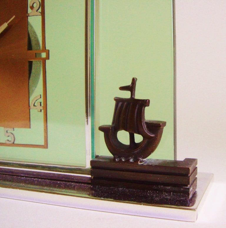 Beveled German Art Deco Glass, Chrome, Copper and Bronze Figural Mechanical Desk Clock For Sale