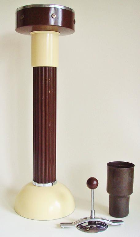 This strongly designed American Art Deco floor standing ashtray was manufactured by Belmet Products of Brooklyn, NY and designed by Charles Hardy (see Hardy's 1938 patent below) the celebrated designer of the company's iconic smoking table and round