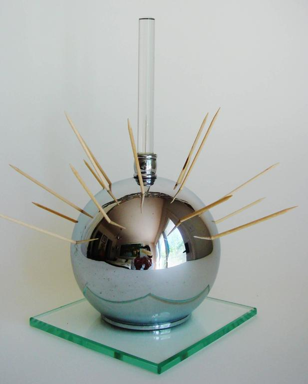 This large American Art Deco cocktail ball was designed to enable the perfect Hostess/host to elegantly offer hors d'oeuvres to guests. It features a crystal rod handle that rises from a pierced chrome sphere which in turns sits on a beveled edge