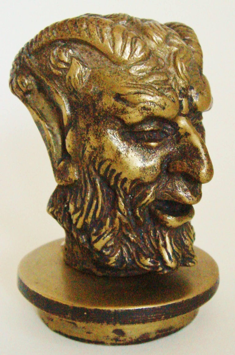 This intriguing French Art Deco, patinated bronze car mascot/hood ornament is designed so that when viewed from the front of the car it features a grinning head of Mephistopheles. However from the driver's point of view, a standing nude female