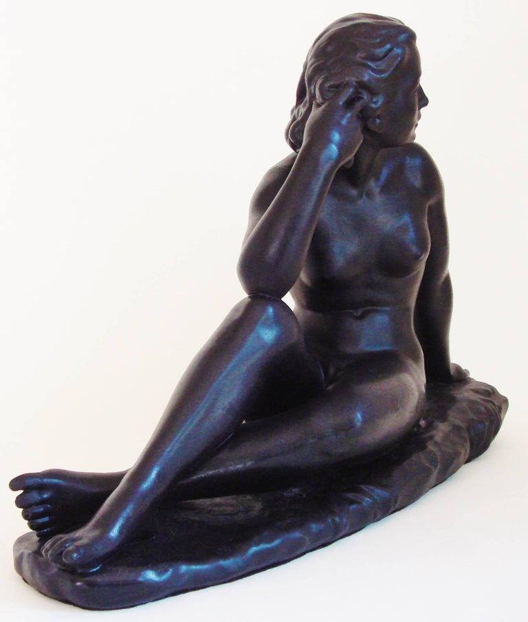 This exquisite Canadian Mid-Century female seated nude was created by Jackir Studios of Toronto in 1965. It is executed in plaster and has no chips or cracks plus all paint is original. We have included pictures taken at all angles plus close ups of