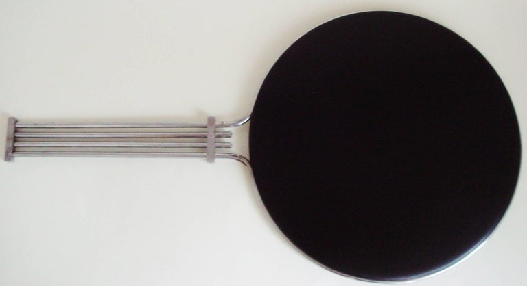 This magnificent, large American Art Deco chrome and black lacquered wood hand mirror is from a department store haberdashery department. These mirrors were used in order that Madame could