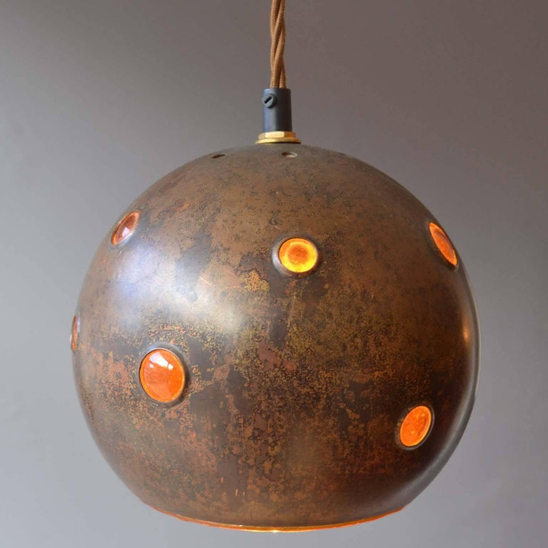 European 1960s Pair of Spherical Copper and Yellow Glass Pendant Lamps by Nanny Still For Sale