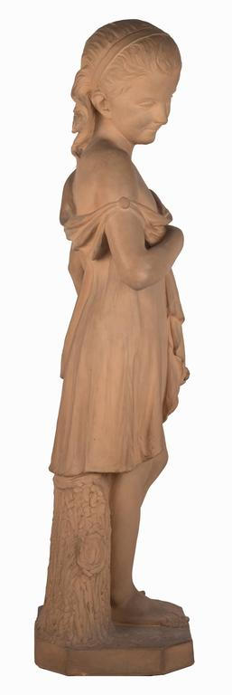 An 19th century French terracotta statue of a young girl, the standing figure in delicately carved drapery leaning against a tree stump with a garland of flowers at her side. The pedestal is incised, CH. LE Bourg 1866.  Lebourg is best known for