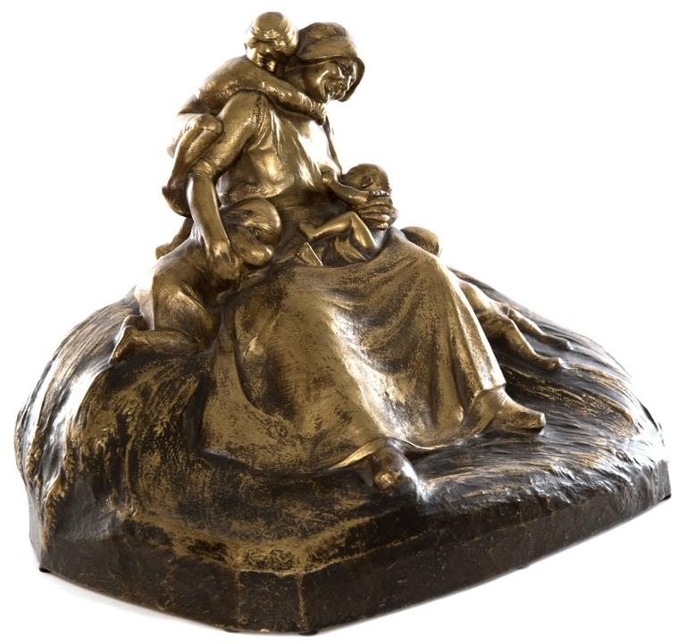 Lucien Charles Edouard Alliot (1877-1967) depicts a mother, exuding strength and love, at the centre of this figural bronze grouping, a smile captured on her face as she lovingly looks upon the infant feeding at her breast, while three young