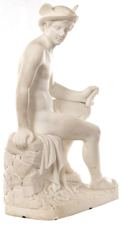 A 19th century marble representation of Hermes, his young, athletic naked form smoothly hewn and naturalistically rendered. Seated on a stone pile draped with fabric, Hermes twists his torso to look over his right shoulder; his curls escape beneath