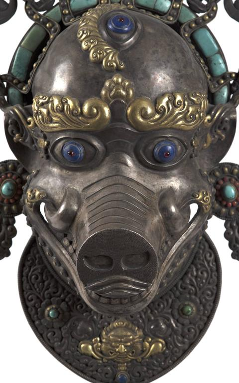 The temples of Kathmandu are guarded by four sow deities, who stand at each of the cardinal points. Dhumbarahi, the grey goddess, protects the north against all enemies, in particular disease. This authentic, nineteenth-century Nepalese statue of