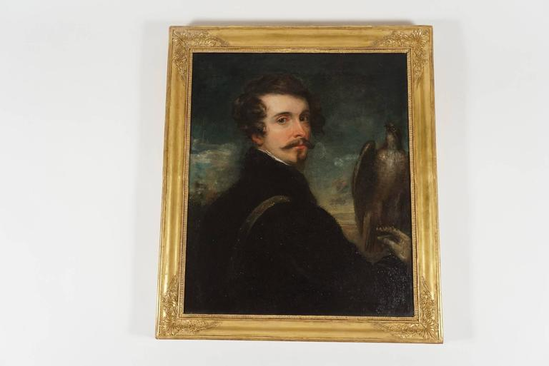 An elegant, circa 1830 German Romantic School oil on canvas portrait painting of a handsome gentleman with a falcon perched on right hand housed in original Empire giltwood frame.  Canvas measures 29.63