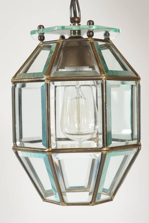 Wonderful Vienna Secessionist (Sezession, Secessionsstil, or Jugendstil) period and style leaded and beveled glass pendant fixture attributed to Austro-Czech architect and designer Adolf Loos (1870 - 1933) of octagonal form having 24 beveled glass