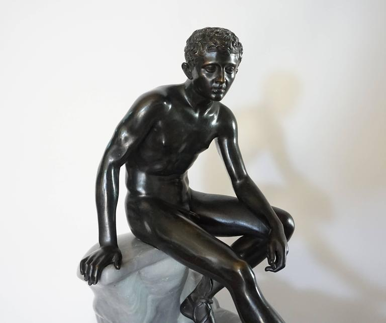 A large and exceptional late 19th century Italian Grand Tour sculpture of the 'Seated Hermes' attributed to the Chiurazzi Foundary, Naples, Italy. The solid lost-wax cast bronze figure seated atop a naturalistically carved Turquin Blue Bardiglio
