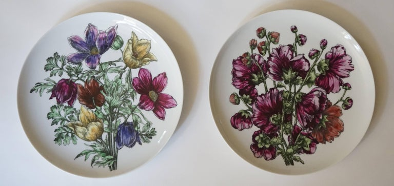 An incredibly rare set of 12 large porcelain dinner plates in the 'Fiori' pattern designed by Piero Fornasetti and produced by Fornasetti - Milano, circa 1965. There are two plates of each design and are marked to the reverse