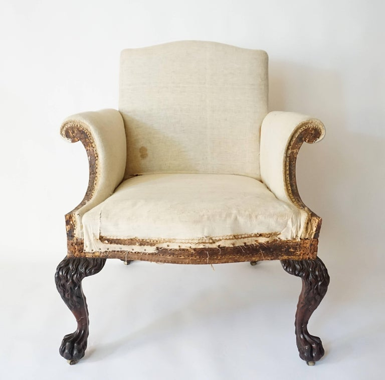 An important and exceptional circa 1905 George II style library armchair of large-scale by the renowned London firm of Lenygon & Company having upholstered