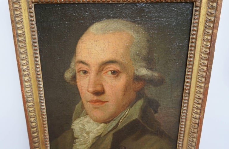 A fine quality circa 1780 oil on canvas portrait painting of a gentleman in powdered wig, coat, waistcoat, and frilled shirt housed in a period giltwood frame having bead and lamb's tongue design. Red wax seal collection stamp and paper label to the
