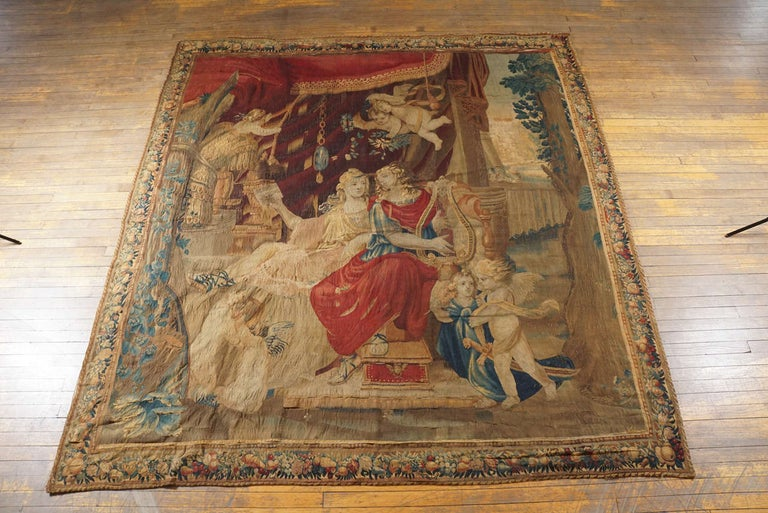 Large circa 1710 French Beauvais tapestry depicting Orpheus playing harp to Eurydice attended by putti with floral, foliate and fruit garland border.  Additional search terms:  Aubusson, Gobelins, Camondo, country house, chateau, baroque, rococo,