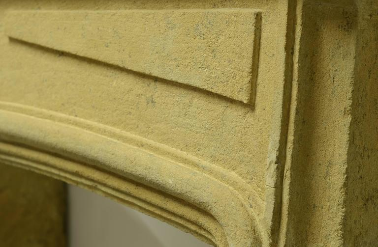 18th Century and Earlier Rustic Limestone Louis XIV Fireplace Mantel For Sale