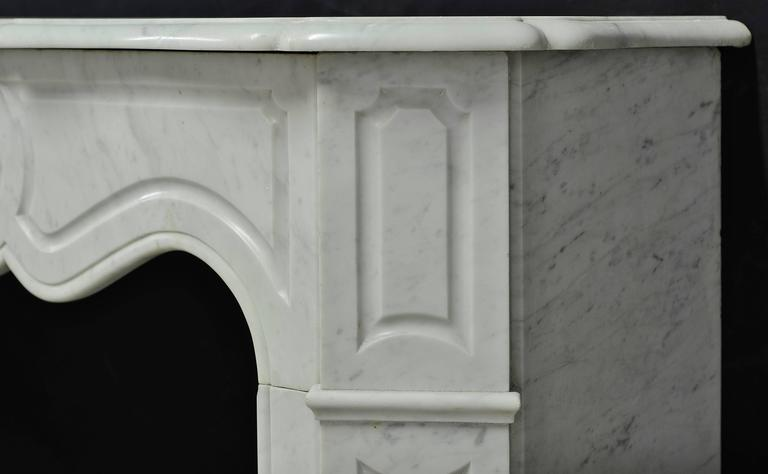View this item and discover similar fireplaces and mantels for sale at 1stdibs - Lovely small Carrara marble Pompadour style fireplace mantel. 19th century