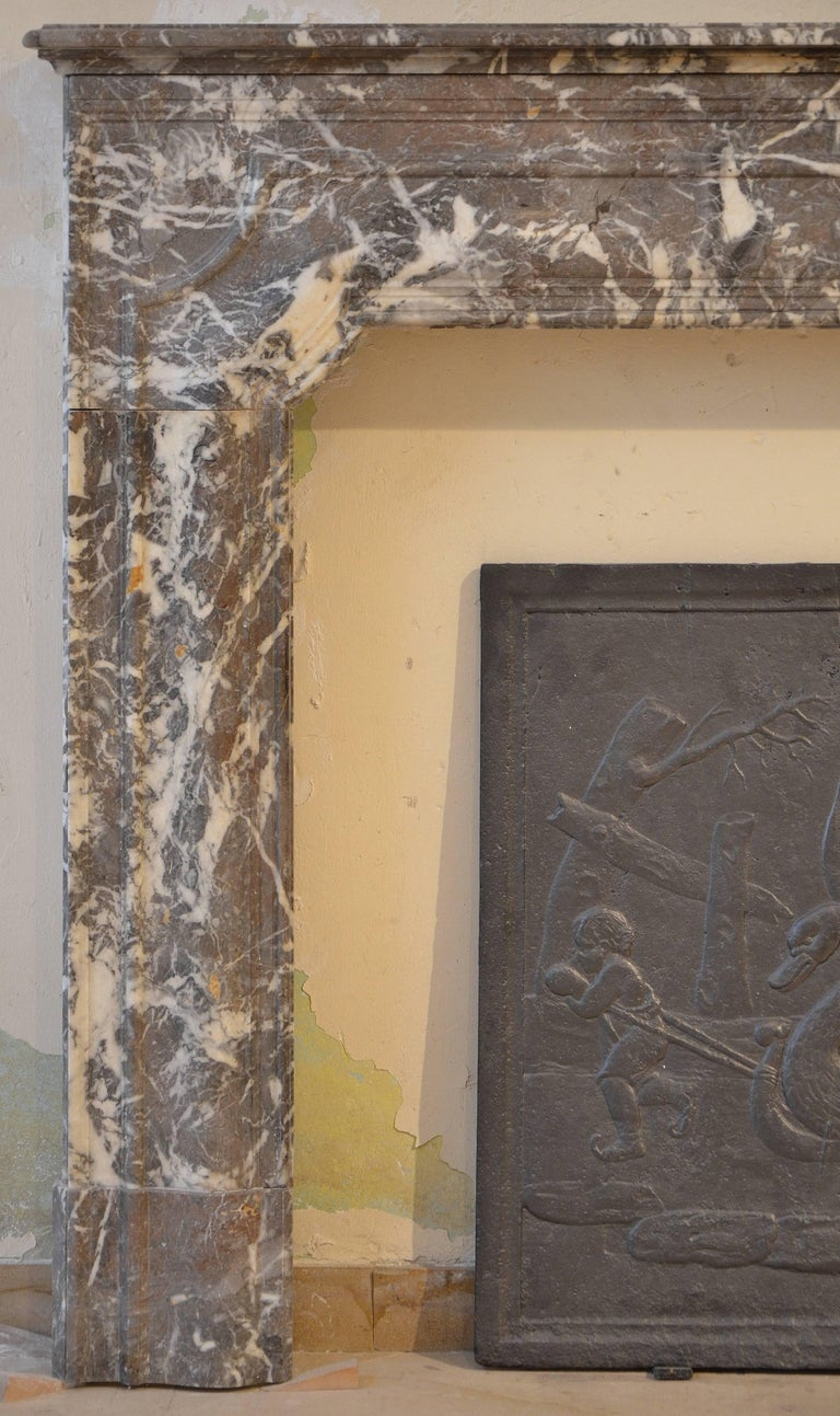 Antique fireplace mantel for the 19th century. This very decorative marble profiled Dutch fireplace is in great condition.