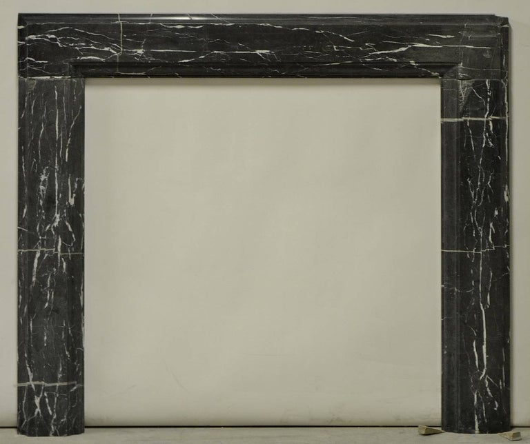 19th century, Bleu Belge marble bolection fireplace mantel.   Opening measurements : 36.2 x 35 inch (height x width).  Has been restored, please see the additional pictures.