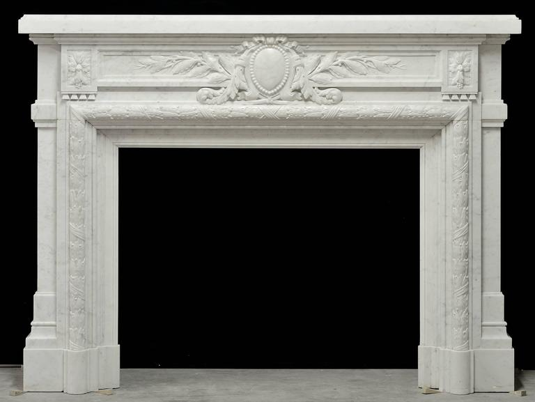 A beautifully carved and unique French Louis XVI style fireplace in Carrara white marble, 19th century.
