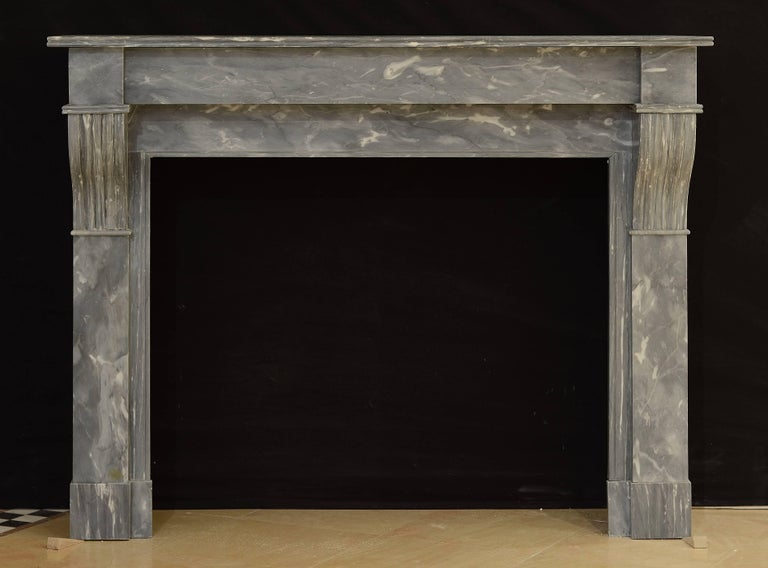 Small, elegant French fireplace in the style of Louis Philippe. Perfect usable size, great condition.  Ready to be shipped an installed.  Opening measurements: 27.1 x 33 inch or 69 x 83.5 cm (height x width).