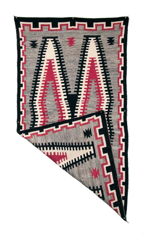 Navajo rug circa 1930. Finely woven from native handspun wool in natural fleece colors of black, ivory and gray with aniline dyed red. Design elements include a stepped border and serrated double diamond center with a grey field.  This textile is