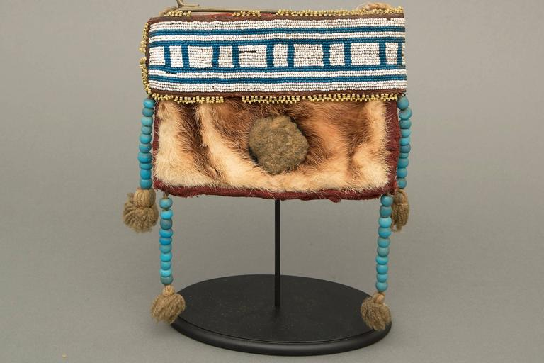 Custom display stand is included.