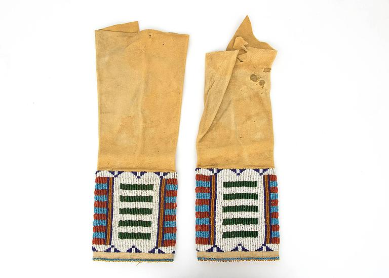 Vintage antique 19th century Native American beaded child's leggings created circa 1875-1900 by a Cheyenne (Plains Indian) maker.  Most likely created for a girl or a young woman, this pair of leggings are constructed of native tanned hide with