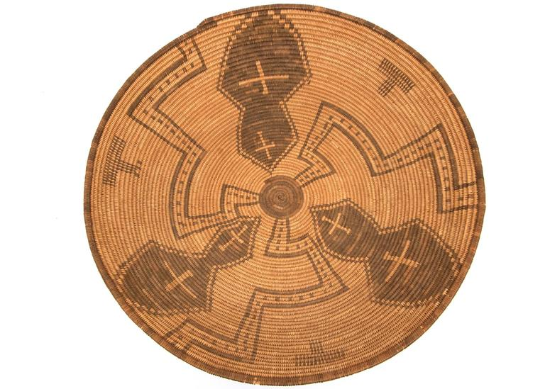 A rounded bowl/tray form masterfully woven of willow and devil's claw with cross and meandering pinwheel elements.